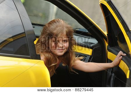 Pretty Girl Looking Out From Yellow Sport Car