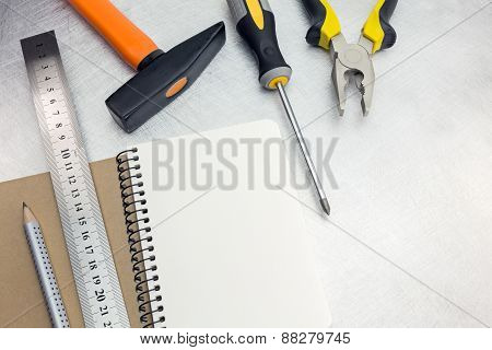 Empty Notepad With Set Of Tools