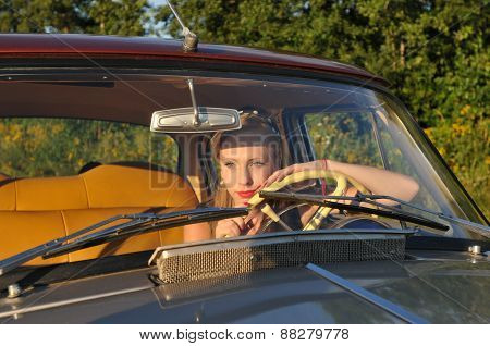 Pretty Woman In Old Car At Sunset