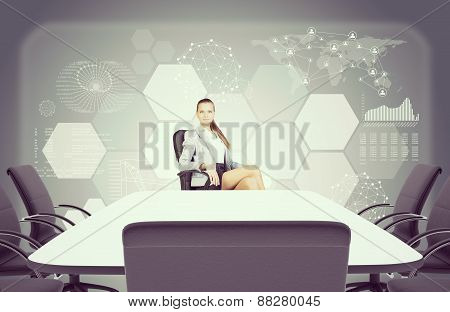 Colorless picture of Business lady sitting at table