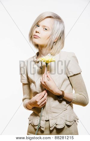 Strange Slim Blonde Girl With A Yellow Flower