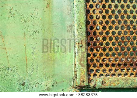 iron plate with holes is covered with old paint