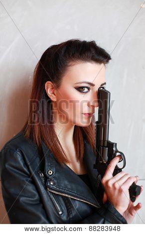 Beautiful Woman Holding A Pistol