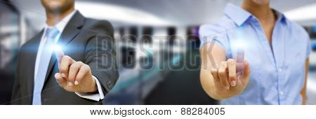 Man And Woman Using Digital Interface
