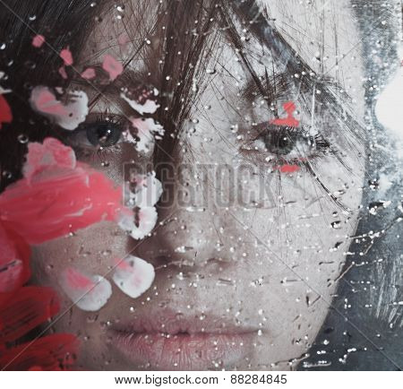 Beautiful Woman Behind Wet Glass