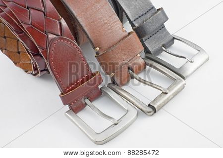 three style of leather belts with white background