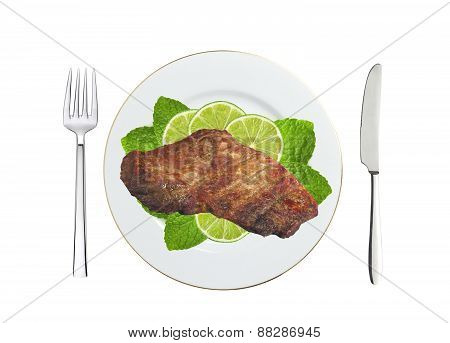 Grilled Steaks And Lime Slices On Plate Isolated On White