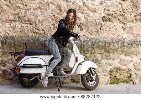 Woman Launching A Old Scooter With Pedal