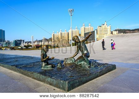 Dalian, China - April 7, 2015 : Sculpture Of Boy And Girl In Xinghai Square. The Square Covers Total