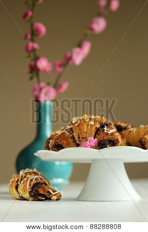 tasty crispy traditional croissants with poppy seeds