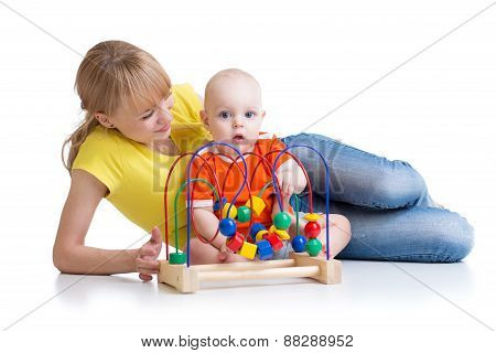 child and mother playing with educational toy