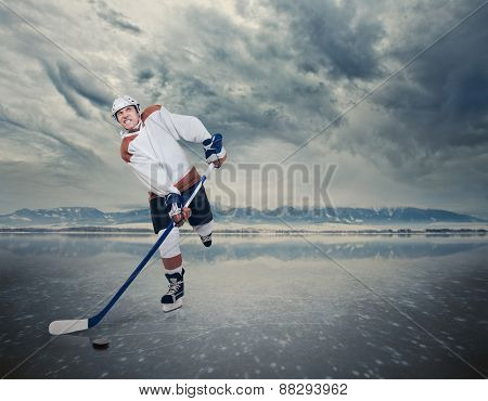 Hockey Player On The Ice Lake Surface