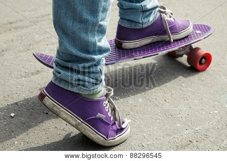 Young Skateboarder In Jeans Riding On His Skate