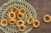 stock photo of doilies  - traditional bagels and lace doily on a wooden table - JPG