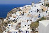image of canopy roof  - white architecture of the village of Ia in Santorini Greece - JPG