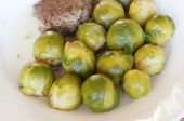 stock photo of brussels sprouts  - Tasty Brussels sprout and meat cutlet Dish - JPG