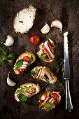 foto of won  - Traditional Italian bruschettas with bacon won wooden backgroundselective focus  - JPG