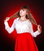 pic of chemise  - Beautiful young woman in a white chemise and a red skirt over bright red background - JPG