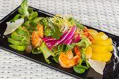 stock photo of tiger prawn  - mango and prawn salad on a light background - JPG