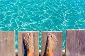 image of under sea  - sandy feet on the pier under tropical turquoise water sea ocean - JPG