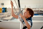image of yachts  - Portrait of young sailor near yacht outdoor - JPG