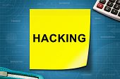 picture of hack  - hacking text on yellow note with graph paper - JPG