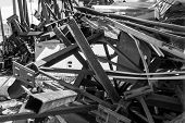 stock photo of scrap-iron  - Scrap metal girders and metalawaits collection for recycling - JPG