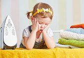 picture of cute innocent  - tired cute little baby girl housewife iron clothes iron is engaged in domestic work - JPG