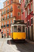 picture of tram  - yellow tram on narrow street of Alfama - JPG