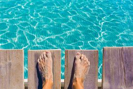 image of under sea  - sandy feet on the pier under tropical turquoise water sea ocean - JPG