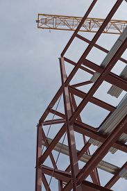 picture of tatas  - A top view of a yellow tower crane and red steel structure on a construction site - JPG