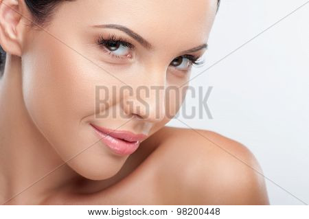 Attractive young woman is flirting with smile