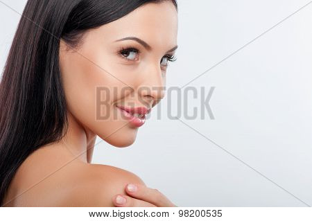 Beautiful young healthy woman prefers skin care