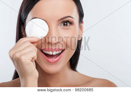 Beautiful healthy girl is washing her make-up
