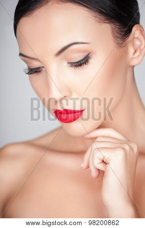 Attractive young woman is caring of her skin