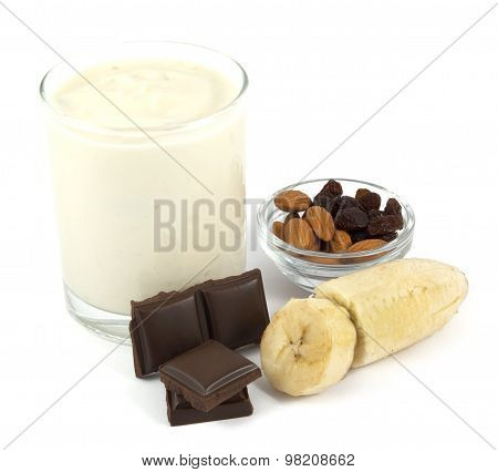 Yogurt with banana, chocolate, almonds and raisins isolated on white