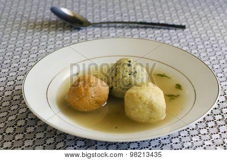 Matzah balls in a bowl of soup