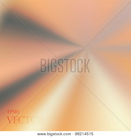 Asymmetric yellow orange light burst with the centre in the upper right third.