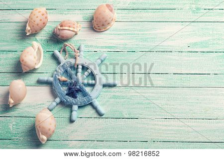 Decorative Helm And Marine Items On Wooden Background.