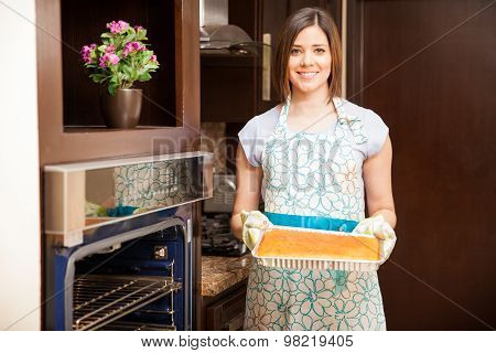 Cute Woman Baking A Cake At Home