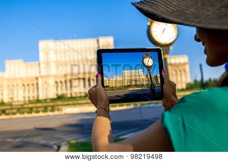 Photographing parliament building in Bucharest