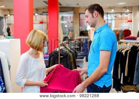 Young Couple In The Clothes Shop
