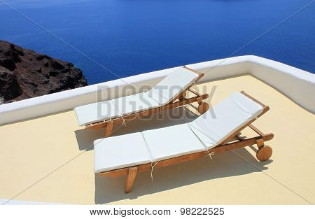 Sunbeds On The Terrace On Santorini Island, Greece.