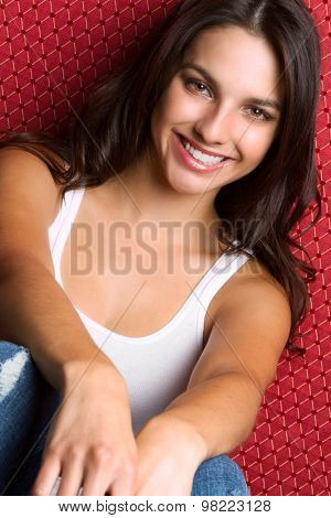 Pretty smiling young brunette woman