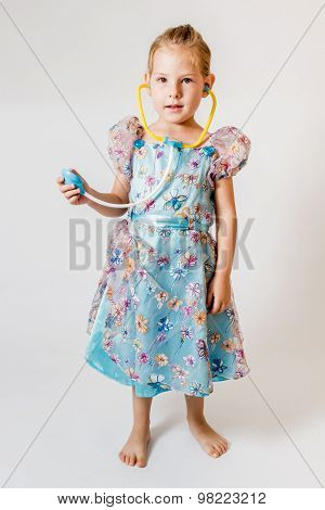 Little Girl Playing With Her Toy Stethoscope