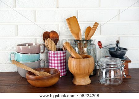 Composition with different utensils on wooden wooden table