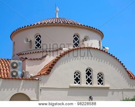 Greek Old Church With Brown Roof Over Blue Sky