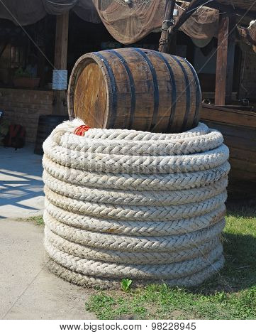 Old Brown Barrel And White Rope Near Fishing Nets
