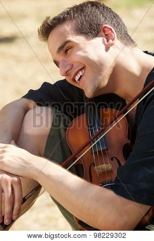 Smiling Man With His Violin