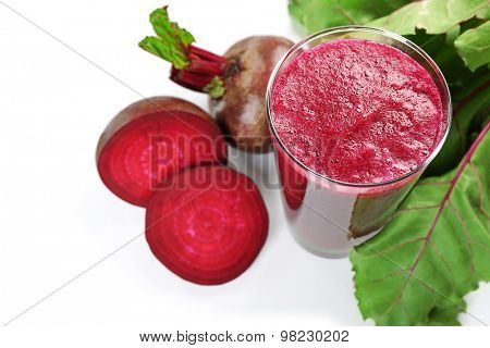 Glass of beet juice with vegetables isolated on white